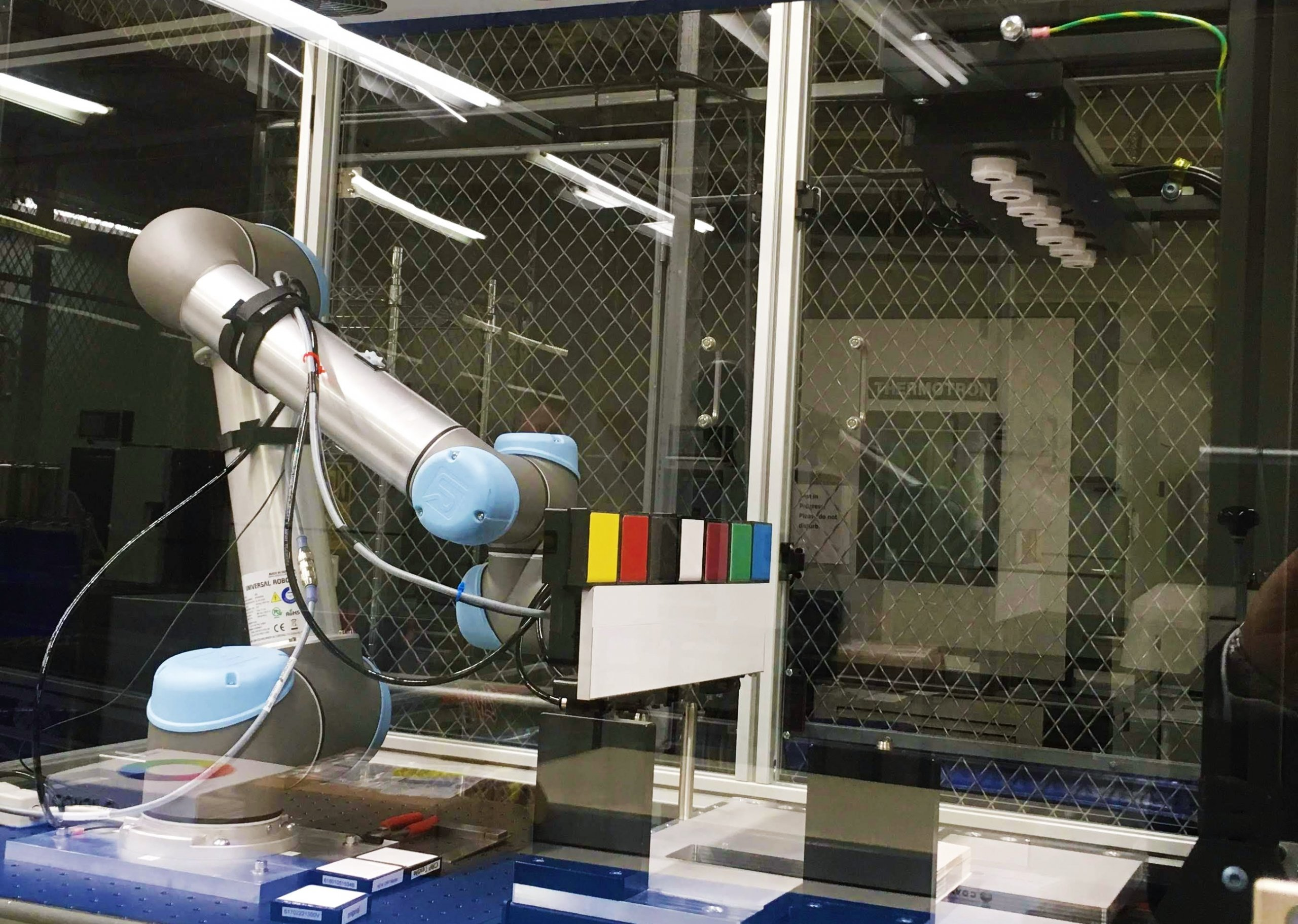 UR5 Collaborative Robot Arm with Custom Fixtures for Lab Use